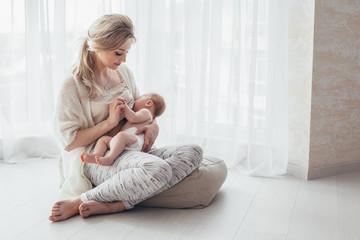 Mom breast feeding baby