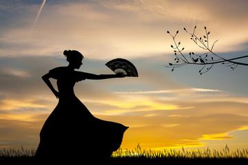 Woman dancing flamenco at sunset