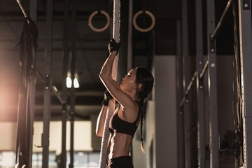 Fit woman exercising with rope