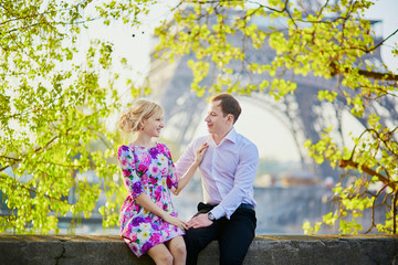 Couple in front of the Eiffel tower in Paris, France