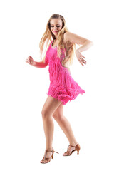 Blonde woman smiling and dancing latino dances in pink fringed costume dress. Side view. Full body isolated on white background.