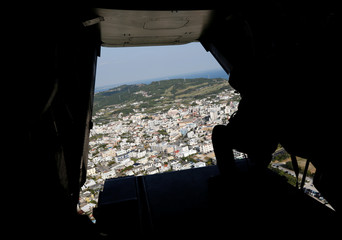Residential area of Ginowan city is seen from rear door of a U.S. Marine Corps MV-22 Osprey aircraft as it heads for the U.S. Marine Corps' Futenma Air Station for the landing in Ginowan