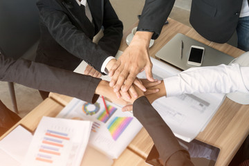 Business people hands together concept.
