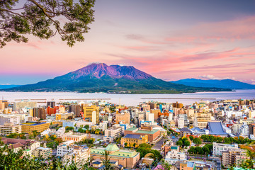 Kagoshima, Japan skyline with Sakurajima Volcano at dusk. Wall mural