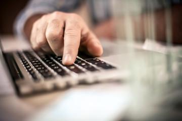 Typing on laptop. Close up.