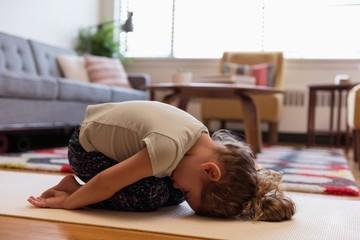 Girl doing meditation in living room
