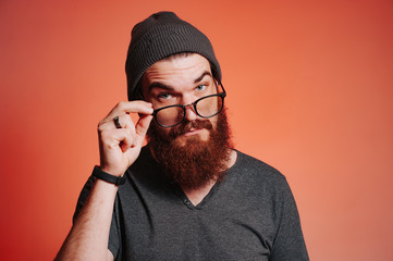 .Hipster bearded man with eyeglasses looking confident at the camera