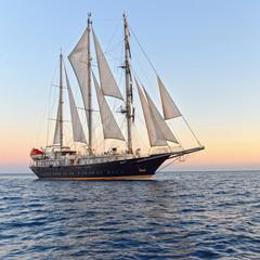 Luxury yacht at sunset. Yachting. Sailing