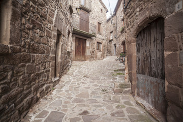 Street village, stone pavement and walls in  L Estany,moianes region comarca, province Barcelona,Catalonia.