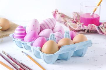 Decorated fresh eggs on white background
