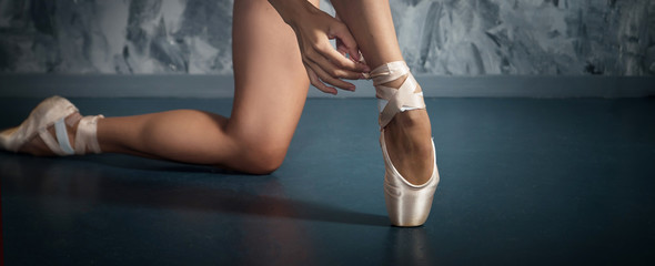Pointe, shoes for ballet dancer. Ballerina, legs