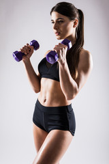 fitness woman with dumbbells on a white background