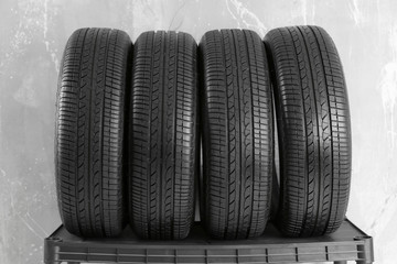 Car tires on grey background