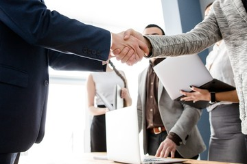 Business people shaking hands finishing up a good deal with new colleagues