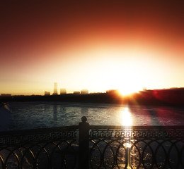 Dramatic light leak near Moscow river city background