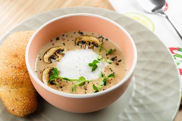 Mushroom cream soup and champignon in bowl