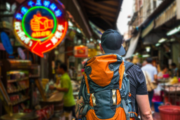Man with backpack in the streets of asian city of Bangkok