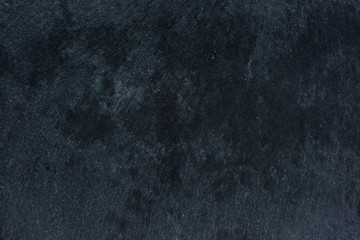 Dark textured surface abstract background