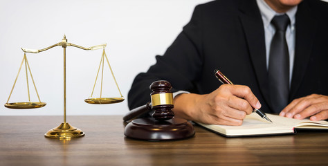 Judge gavel with Justice lawyers, Businessman in suit or lawyer working on a documents. Legal law, advice and justice concept