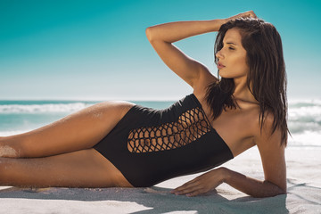 Beauty woman lying on sand