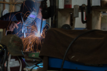 Sparks fly as the welder does his work.