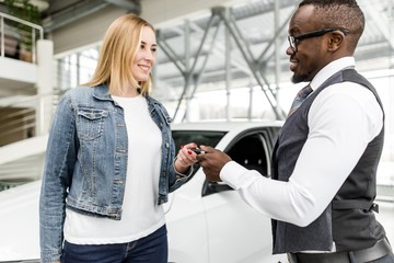 African man gives the girl the keys to a new car