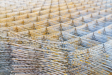 iron mesh or wire mesh texture background for backdrop or wallpaper, wire mesh or iron mesh use for reinforce concrete in construction site