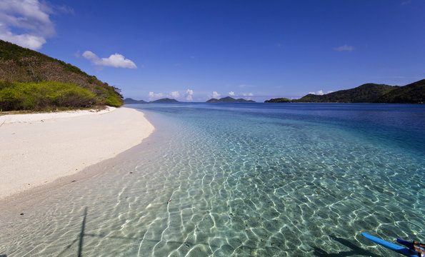 A tropical lonely beach by crystal sea water