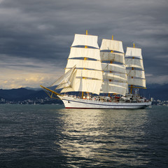 Sailing ship and storm sky. Yachting. Sailing