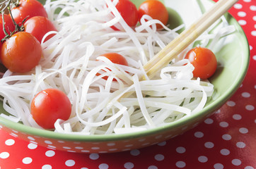 Dietary menu. Vegan cuisine. Tomatoes  and noodles