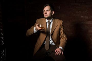 Man in suit tastes expensive cognac