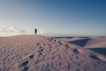 Photo sur Toile Desert de sable Man is running on sand dunes in Maspalomas.