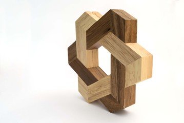 star-shaped wooden puzzle game