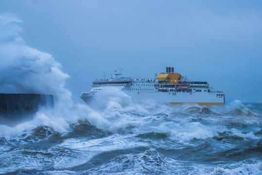 Storm Force. Ship struggling to make the safety of the harbour. Newhaven East Sussex, UK