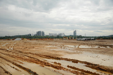 Construction site at early stage during daytime. Some area earthwork still ongoing.