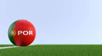 Soccer ball in portuguese national colors on a soccer field. Copy space on the right side - 3D Rendering