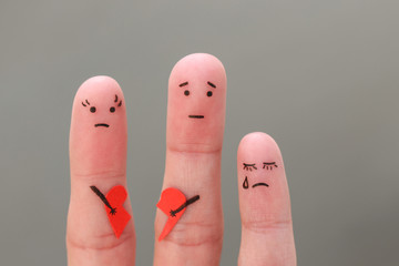 Fingers art of family during quarrel. Concept of parents had fight, child was upset.