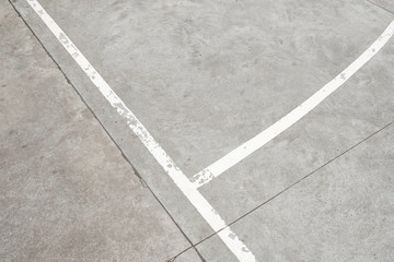 white lines on concrete floor - vintage sport background