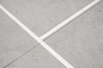 sport field lines closeup - white lines on concrete floor