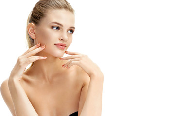 Charming blonde girl with perfect skin on white background. Copy space for your text. Beauty & Skin care concept