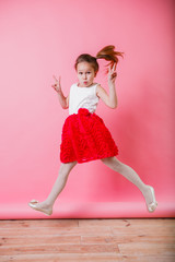 Little girl emotions on pink background