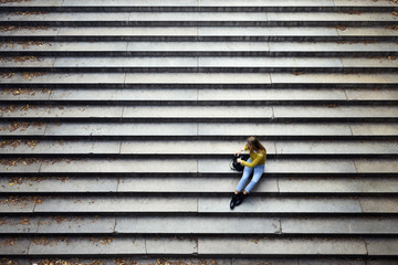 High angle view of woman sitting on steps at park