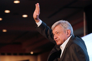 Leftist front-runner Andres Manuel Lopez Obrador of the MORENA waves to the audience after a conference in Guadalajara
