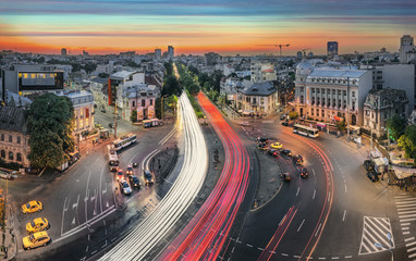 Aerial view of the Romana Square at sunset in Bucharest, Romania. Traffic lights after rain. Fotomurales