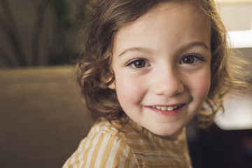Close-up portrait of cute smiling girl