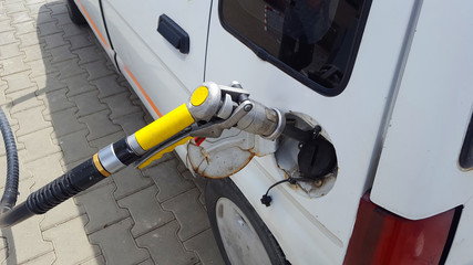 Pumping gas in car