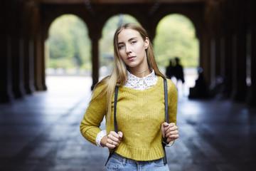 Portrait of woman standing at park