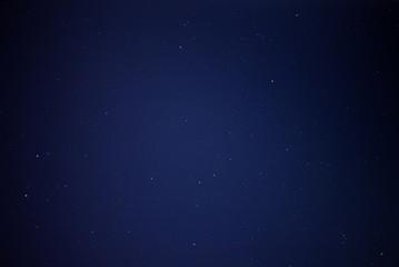 A blue night sky full of stars
