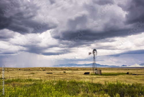 Sonoita Arizona ranch land  Windmill and rain shower visible