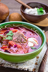 Bowl of borscht. First dish with beetroots, cabbage and beef. Traditional Russian and Ukrainian cuisine